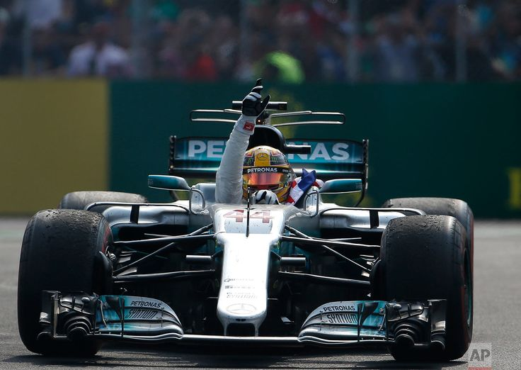 Mexico F1 GP Auto Racing Mercedes driver Lewis Hamilton, of Britain, celebrates at the end of the Formula One Mexico Grand Prix auto race at the Hermanos Rodriguez racetrack in Mexico City on Oct. 29, 2017. Hamilton won his fourth career Formula One season championship with a ninth-place finish at the Mexican Grand Prix in a race won by Red Bull's Max Verstappen. (AP Photo/Eduardo Verdugo)