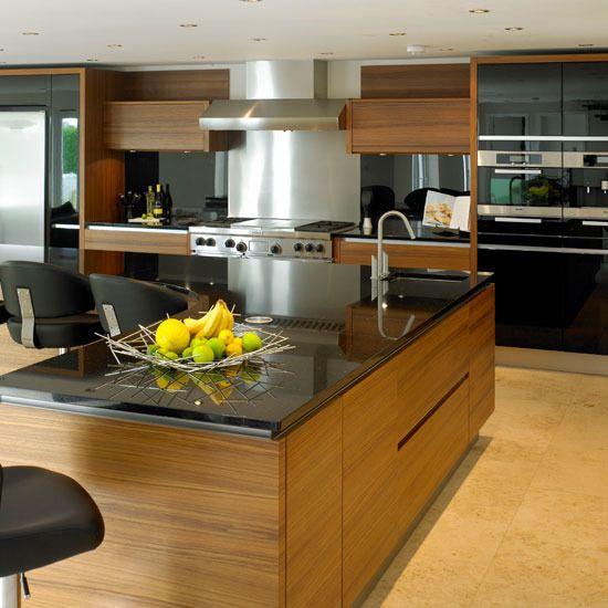 teak cabinets with dark countertops