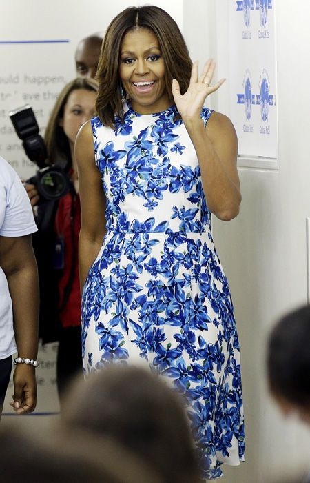 2014 - For an event at Global Kids Incorporated in New York City, the First Lady donned a white and blue floral Tanya Taylor frock with metallic silver pumps.