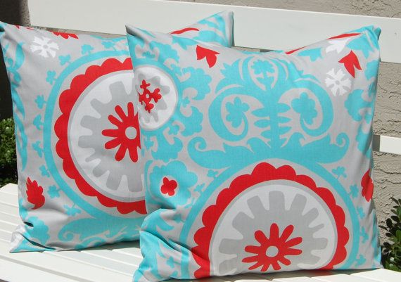 love these red, turquoise and gray pillows. perfect accessory for my red couch!