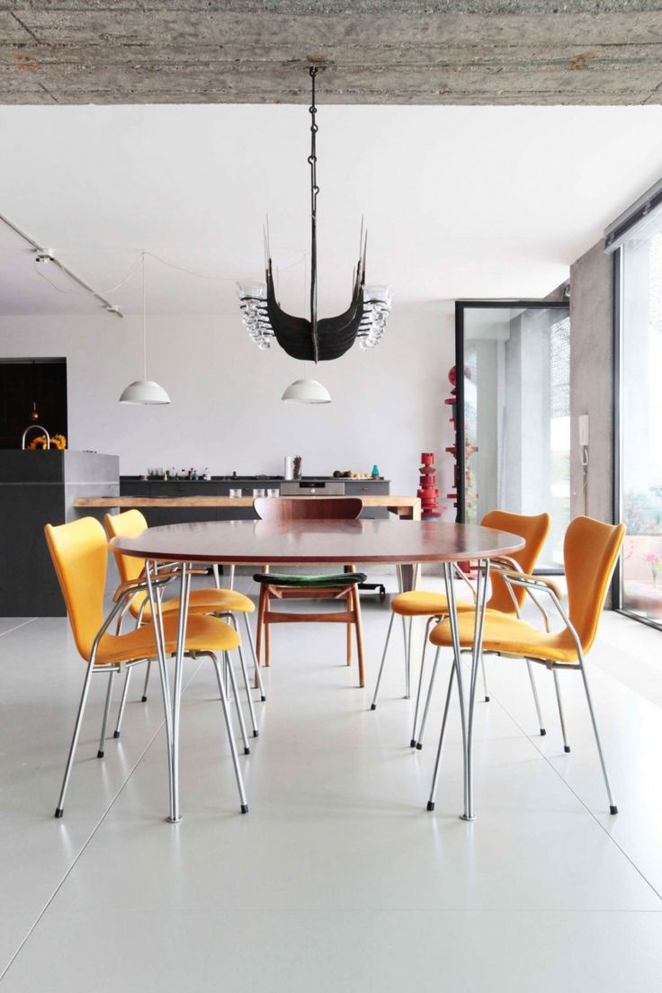Loft: Spacious Pallars Loft Interior with Minimalist Style in Barcelona, Spain by KAYSERSTUDIO, Dining Room in Open Floor Pallars Loft Interior with Round Wood Top Table and Chic Yellow Chairs also Decorative Pendant Lamp Set by KAYSERSTUDIO