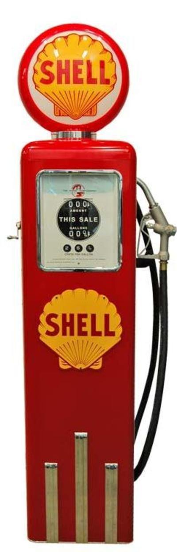 Pompe à essence avec globe en verre lumineux, finition rouge et jaune SHELL. Disponible sur notre site internet :