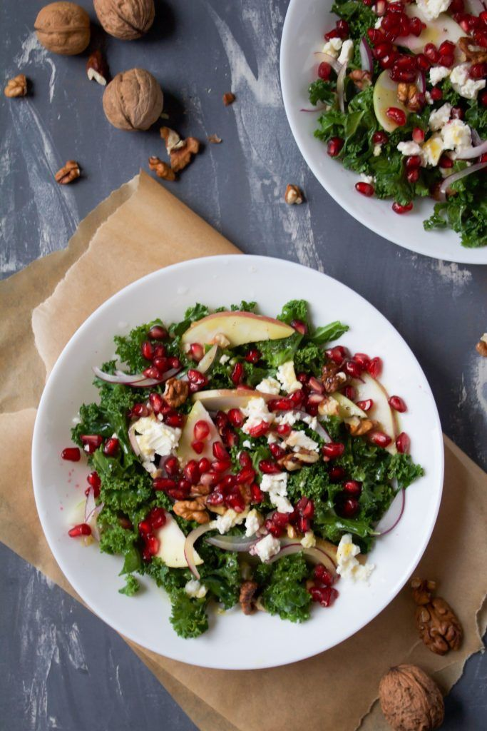 Salad with kale, apples, pomegranate and feta cheese.