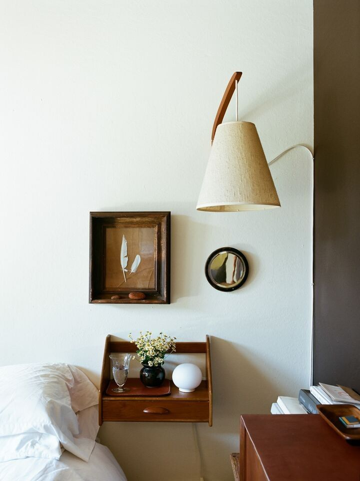 Note the shape (esp. curved sides) of wall mounted bedside table - could make as a shelf w/out drawer, in steel from Leslie Williamson at Home by Brian Ferry | Remodelista