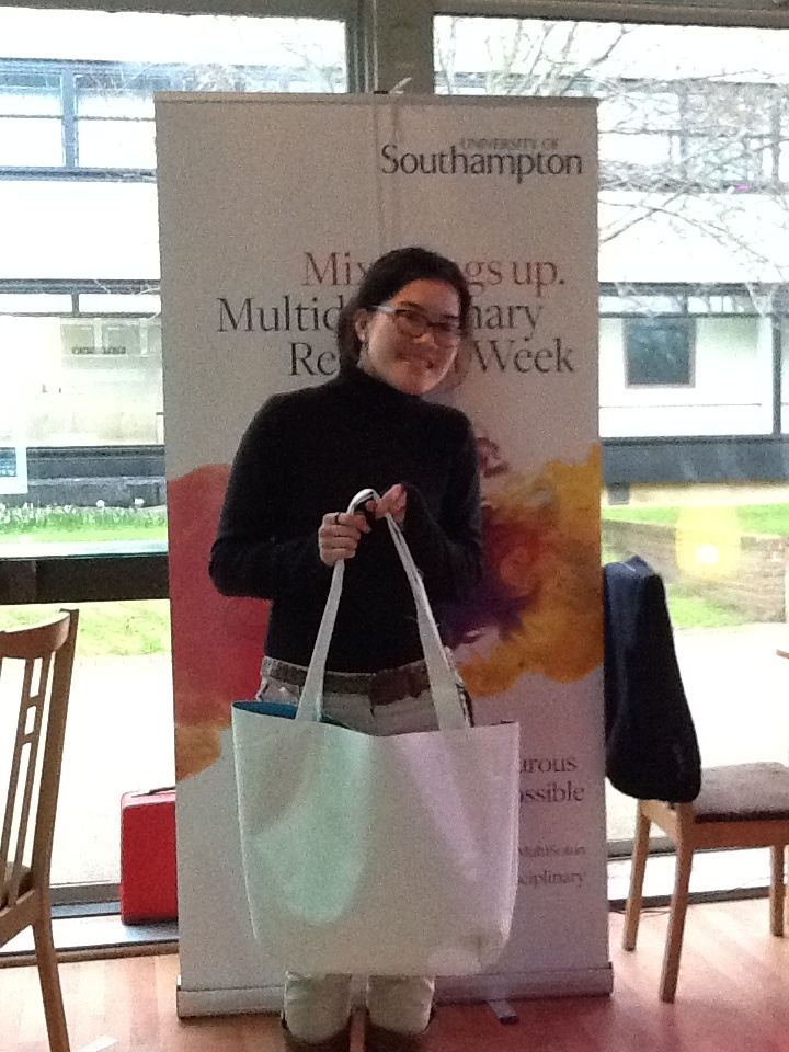 A Green Shopper showing off the lovely design of the tailored made 'Changing the World for 60 Years' eco-friendly bag.