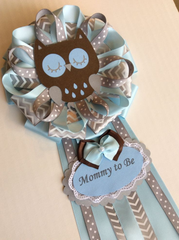 This beautiful corsage measures approx 6x13 long. Made with sattin Ribbon and a cardstock Owl cutout. Will fit perfectly on a Owl Baby Boy shower. Made in a clean, pet free non smoking home.