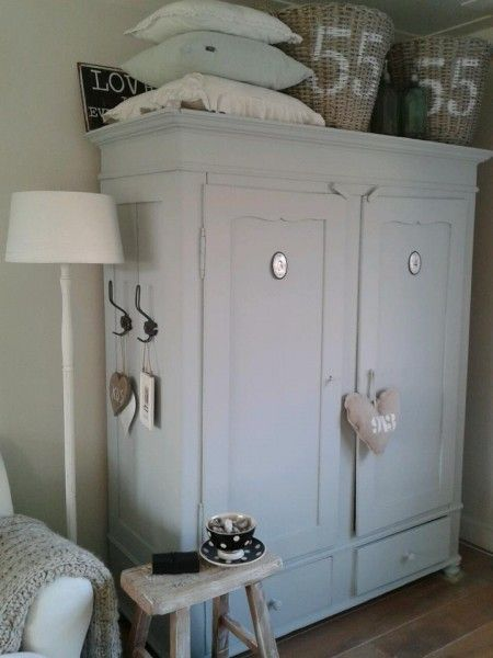 Painted free-standing cabinet.  I like the hooks on the side
