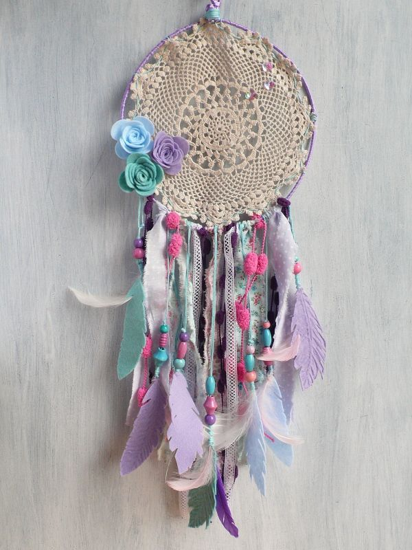 Hippie chic DIY dream catcher. Perfect for a home décor project.  Created by Anna Draicchio with: Sizzix Big Shot Plus Machine 660020, Sizzix Bigz Die - Love Birds 3-D Rose 660834, Sizzix Bigz Die w/Texture Fades - Feather Duo 660237, Crochet Doily, Wire, Felt, Feathers, Wooden beads – assorted, Ribbon, Fabrics, Lace, Hot Glue Gun