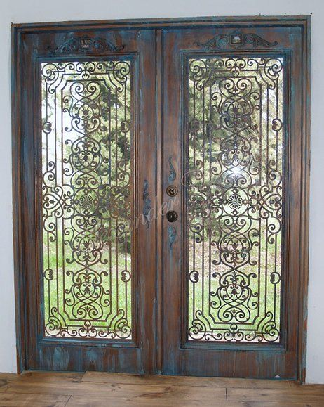 Plain white Home Depot metal doors are made to look like Old Bronze wrought iron doors with ornaments stencils from Royal Design studio alexandercook   COLLECTION