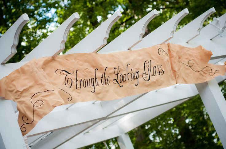 Through the Looking Glass sign for a fairy tale wedding reception bar. Event Design by All in the Details, LLC