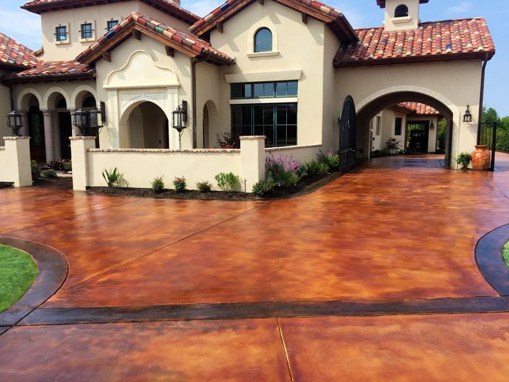 Stained concrete driveways is an easy way to to enhance your home with beauty.