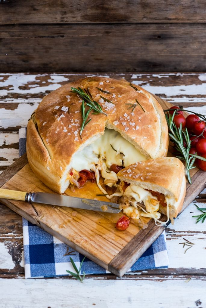 Gourmet Stuffed Braai Loaf.  Freshly baked bread stuffed with caramelised onions, roasted tomatoes, some grilled peppers and two cheeses.