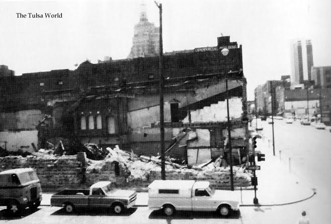 The Lynch Building, Tulsa, OK, during demolition. The building was one of Tulsa's first movie theaters, The Lyric.  As the 2-foot thick walls of hand-cut stone crumbled down, onlookers could see some of the balcony and decorative false windows.