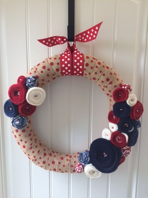 Show your American pride with this 18 inch wreath is intricately wrapped in burlap and adorned in hand cut felted floral blooms.