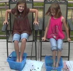 Marble Race –-using only your feet, how many marbles can you get out of a bucket of water in just one minute? Fun!
