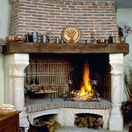 like the thicker reclaimed wood look of the mantel Village style decorative brick corner