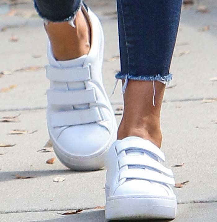 Age is just a number: Jessica Alba dons a youthful pair of Kenneth Cole velcro sneakers