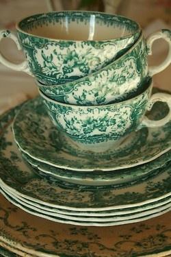 teacups in green transferware