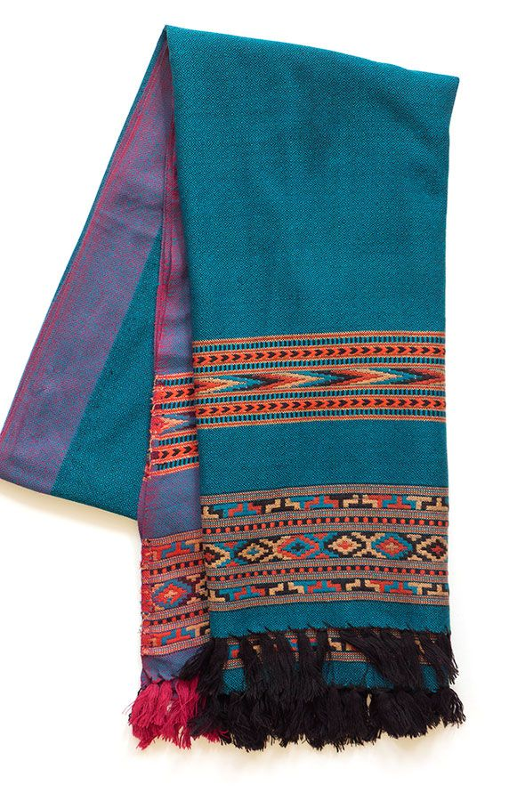 Stunning handloom pure wool shawl in striking teal, orange and red design. from the Kulu Valley in Himachal Pradesh. Buy at http://naggarvalley.com/product/hand-loom-woollen-shawl-green-blue-orange-black-diamond-weave-with-chevron-design/