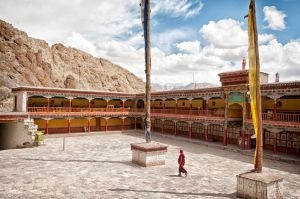 Monk in the courtyard; at Hemis Gompa, Ladakh