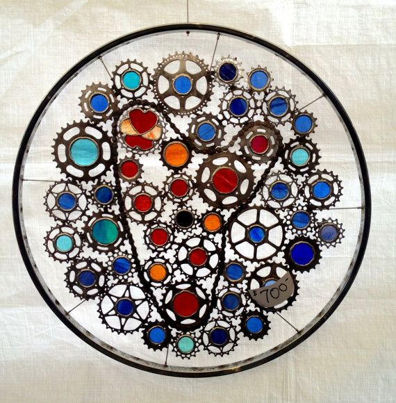 Bicycle Wheel Art - Bicycle gears and stained glass sculpture.