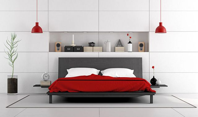 Create this gorgeous contemporary bedroom by utilizing a bold red bedspread with some accents to match. If you can't find the dramatic hanging lamps like the ones in this photo, a pair of great table lamps would be perfect on the nightstands or even a tall corner lamp to add some depth. The red cuts against the white creating a perfect space for the modern soul.