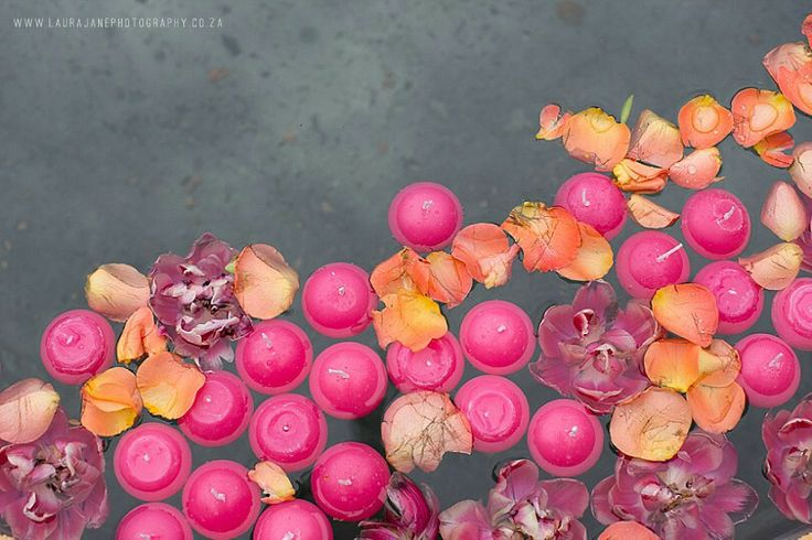 Flowers and candles floating in the fountain