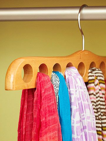 Clothes Hanger        This specially designed hanger has holes to neatly display and store up to 10 scarves. The hanger puts scarf options in plain sight and eliminates rummaging through a drawer to find the perfect one.