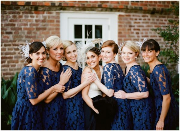 navy blue lace overlay bridesmaids dresses from Anthropologie AND the webpage has a ton of blue wedding  ideas