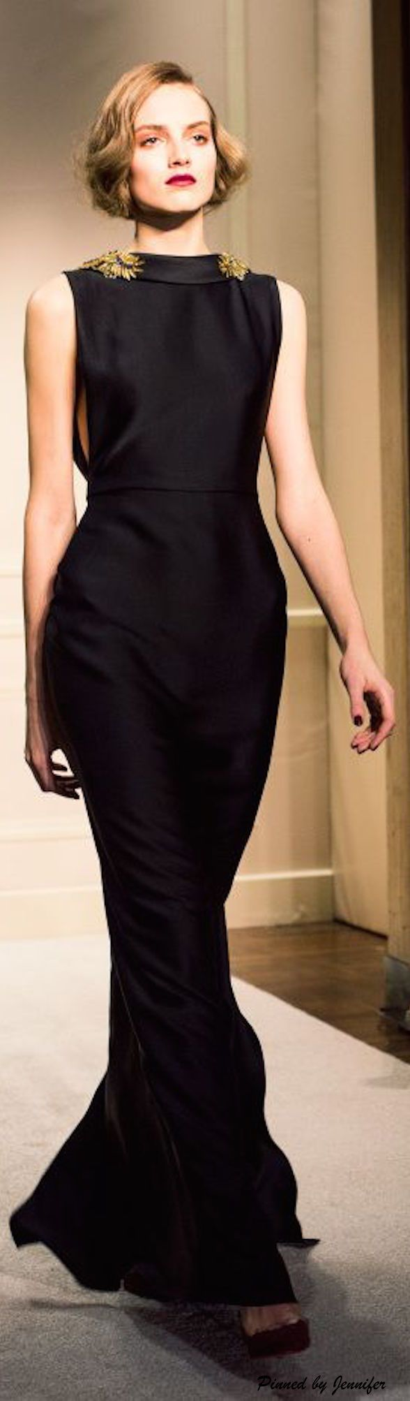 Class and importance in one dress. The black mermaid gown is lovely and timeless, and the gold decoration around the neckline adds that little pop of fun and style without losing any respect.