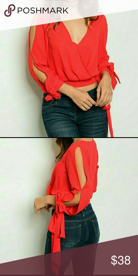 Cropped cold shoulder red blouse Gorgeous red cropped blouse with cold shoulder.  It has a hidden zipper; semi-cropped open sleeves with side ties unknown  Tops Blouses
