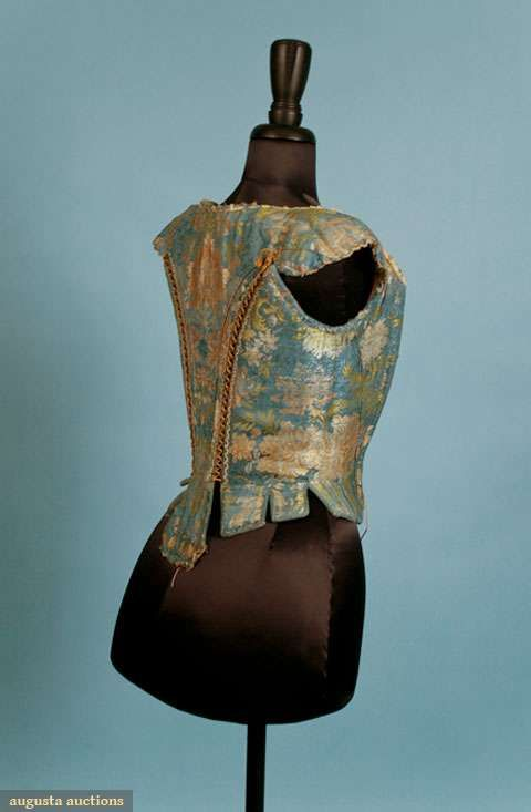 French blue silk w/ peach, ivory, & green brocade, CF eyelets to have laced to stomacher, short cap sleeve, cane boning, stays constructed i...