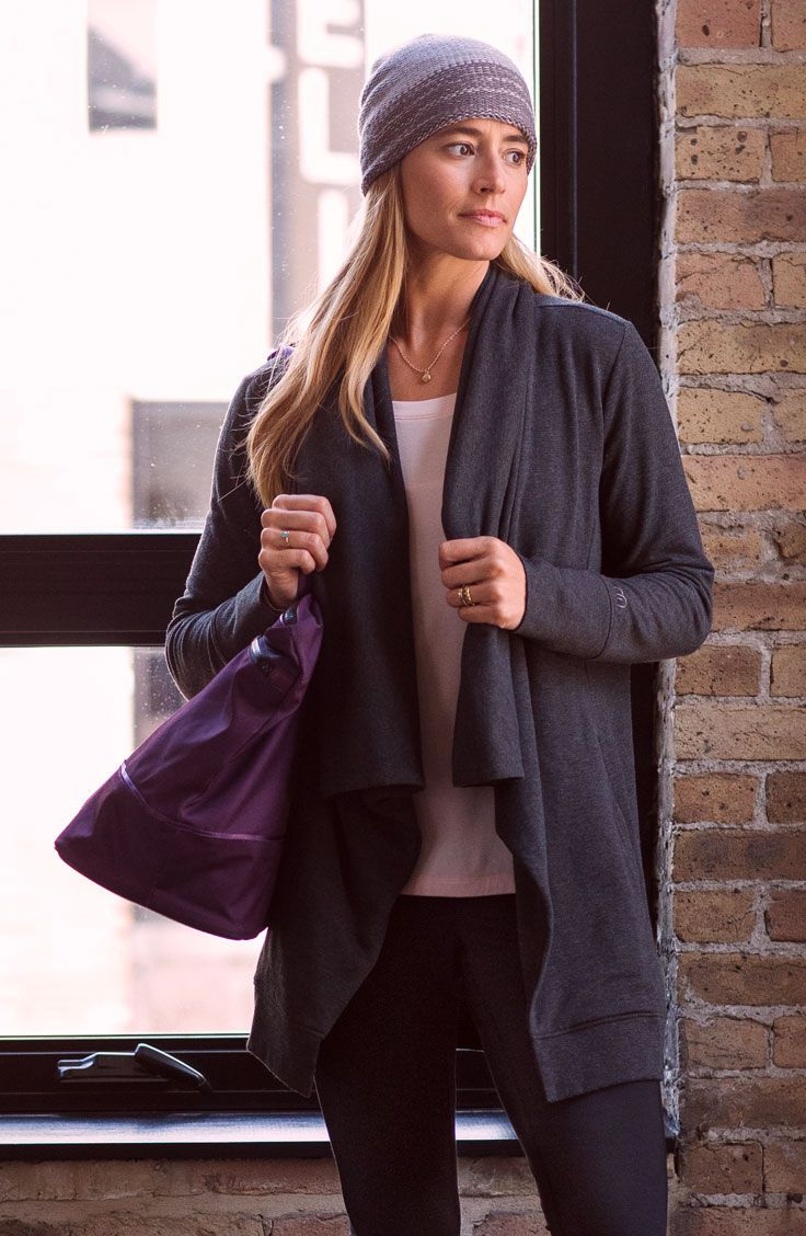 Flawlessly flow from studio to street to store in the CALIA™ by Carrie Underwood Women's Effortless Fleece Coat. Soft fabric brings smooth comfort while still blocking out the chill. Antimicrobial technology adds freshness, and thumbhole cuffs offer a snug fit. The draped design and wide neck make for laidback style that pairs perfectly with your other pieces. Get from place to place feeling great in the CALIA™ Effortless Fleece Coat. | CALIA by Carrie Underwood