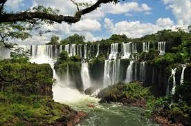 Iguazu Falls - (Port. Cataracas do Iguacu; Sp. Cataratas del Iguazu) is situated near the border of Brazil, Paragual and Argentina and is listed on the UNSECO World Heritage List.  Taller than the Niagra and twice as wide it is a spectacular vision which can be accessed from all three bordering countries