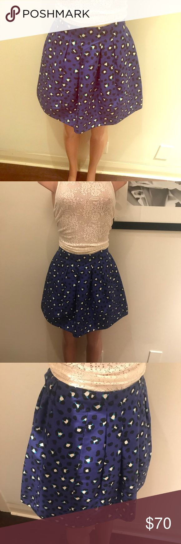 KATE ♠️  Cyber cheetah skirt KATE SPADE ♠️ NYC♠️ four (but fits a 4-8 easily)♠️ super stretchy expandable waistband, synches in the back with a always smooth front♠️ the skirt itself is an A frame skirt, it's not stretchy it's still, to hold its vintage looking shape at all timesblue/Black/White, the cyber cheetah is one sexy skirt, with front pockets ? SAY WHAT?!!  Yesss!!!  Tag has been cut out (sorry) FYI; I am not a size 4, it was the only size they had left, so I purchased it anyway…