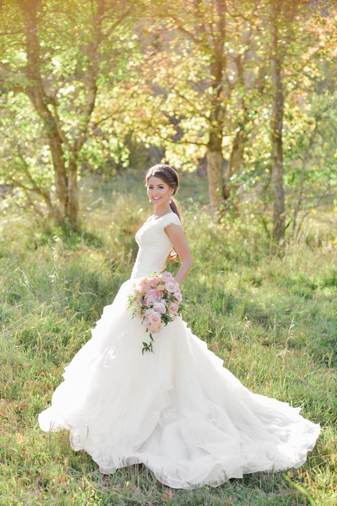 modest wedding dress with short sleeves from alta moda.         ------                      photo: rebekah westover