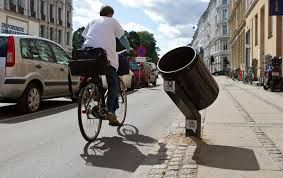 Angled dustbins for cycle-by disposal