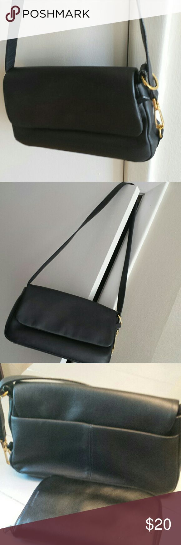 """Deepest Navy Shoulder Bag Classy flap over with magnetic snap.  There is a zippered pocket (as long as the purse) under the flap, then another zippered pocket and 2 slots.   To polish it off, there is a large slot on the back.  There is a little wear on one side of the strap (doesn't show unless you look for it) and a lite fade on the main flap (last picture) that doesn't show unless the light hits it just right.  11x7x3 with a 35"""" strap. (Picture 3 has a black leather wallet next to purse…"""