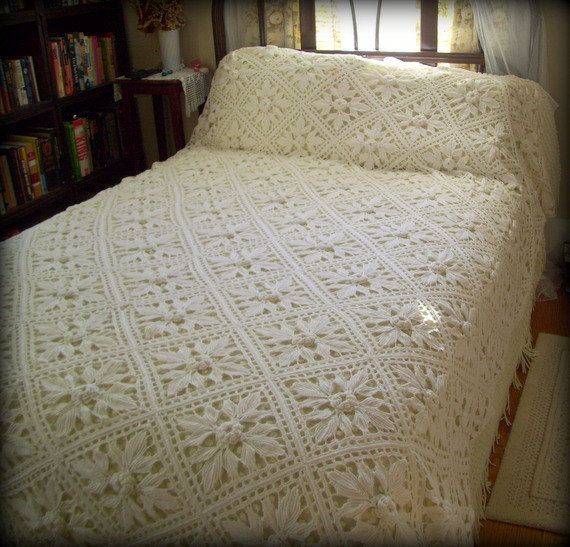 ~Vintage hand crocheted coverlet in off white cotton.  ~Crochet 3 dimensional rosette squares with beautiful handmade fringe.  ~Stunning