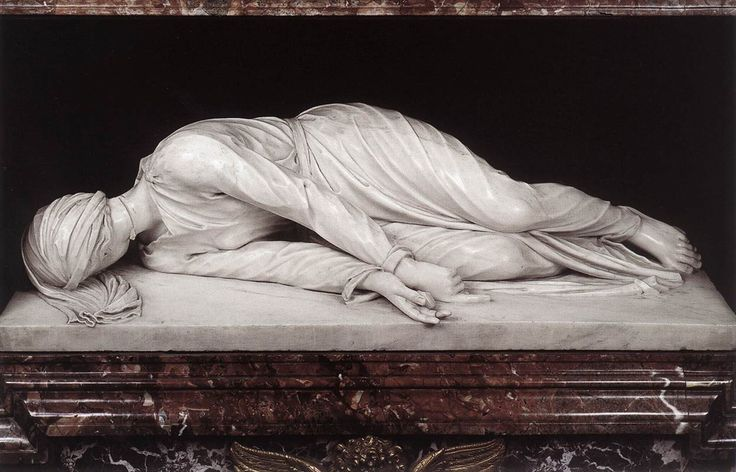 Memorial sculpture of St Cecilia(patron saint of musicians) by Stefano Maderno marks the gravesite of the rediscovered body of the martyred saint in 1599. Depicts the saint as she lay dying in her last moments and mimics they way her corpse was found in the grave, uncorrupted. She wore a dress and her face was toward the ground...an incision in her neck was visible.