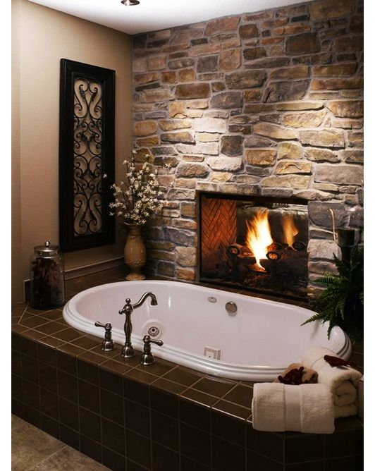 Love this! Fireplace by tub