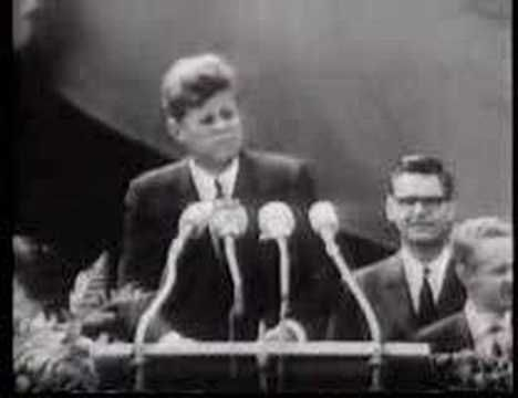 """June 26th, 1963: President Kennedy famously utters the phrase 'Ich bin ein Berliner"""" while speaking at the Berlin Wall."""