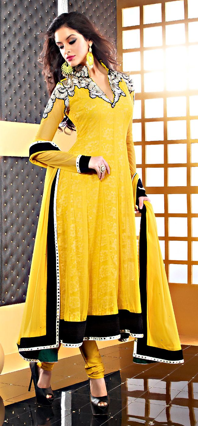 "Yellow Color Faux Chiffon Fabrics Salwar Suit  ITEM CODE :- SLRC2110  PRICE:- 5295/- INR  Style: Salwar suit sleeve style: Sleeveless, Long Sleeve (18"" to 21"") size: 38"", 32"", 36"", 34"", 42"", 40"" occasion: Party, Wedding, Festival fabric: Faux Chiffon color: Yellow Catalog No.: 1150 work: Embroidered, Resham , Zari  SHOP THIS SUIT FROM HERE http://www.vivaahsurat.com/salwar-kameez/yellow-color-faux-chiffon-fabrics-salwar-suit-slrc2110"