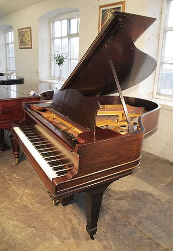 An unrestored, 1893, Steinway Model A grand piano for sale with a rosewood case and spade legs at Besbrode Pianos. Piano has an eighty-five note keyboard and a three-pedal lyre.