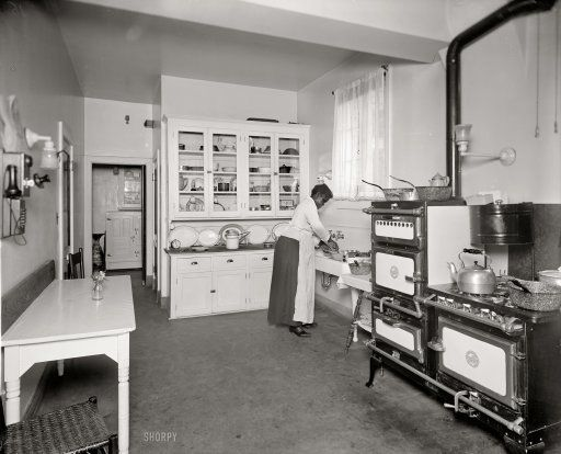 An inspiration kitchen from 1920. Many of the cabinetry details are going to make it into our kitchen. I wish the oven could too.