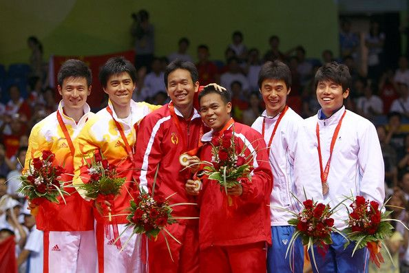 Cai Yun (L-R) Silver medal winners Cai Yun and Fu Haifeng of China, gold medal winners Hendra Setiawan and Markis Kido of Indonesia and bronze medal winners Hwang Jiman and Lee Jaejin of South Korea pose during the medal ceremony for the men's doubles badminton at the Beijing University of Technology Gymnasium on Day 8 of the Beijing 2008 Olympic Games on August 16, 2008 in Beijing, China.