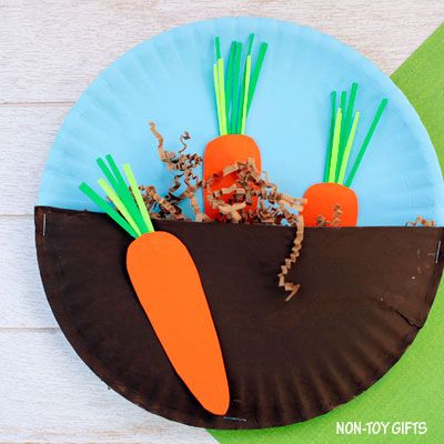 "A simple CARROTS IN THE GARDEN CRAFT for toddlers and preschoolers. Kids will paint paper plates, cut out carrots and place them in ""dirt""."