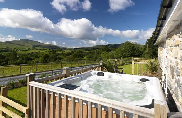 3 bedroom 18th century barn conversion in North Wales.  Hot tub with spectacular mountain views.  And a childminding service!