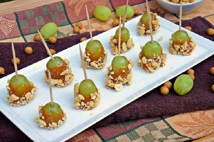 """Baby"" caramel apples. Just dip grapes in caramel and your favorite toppings."