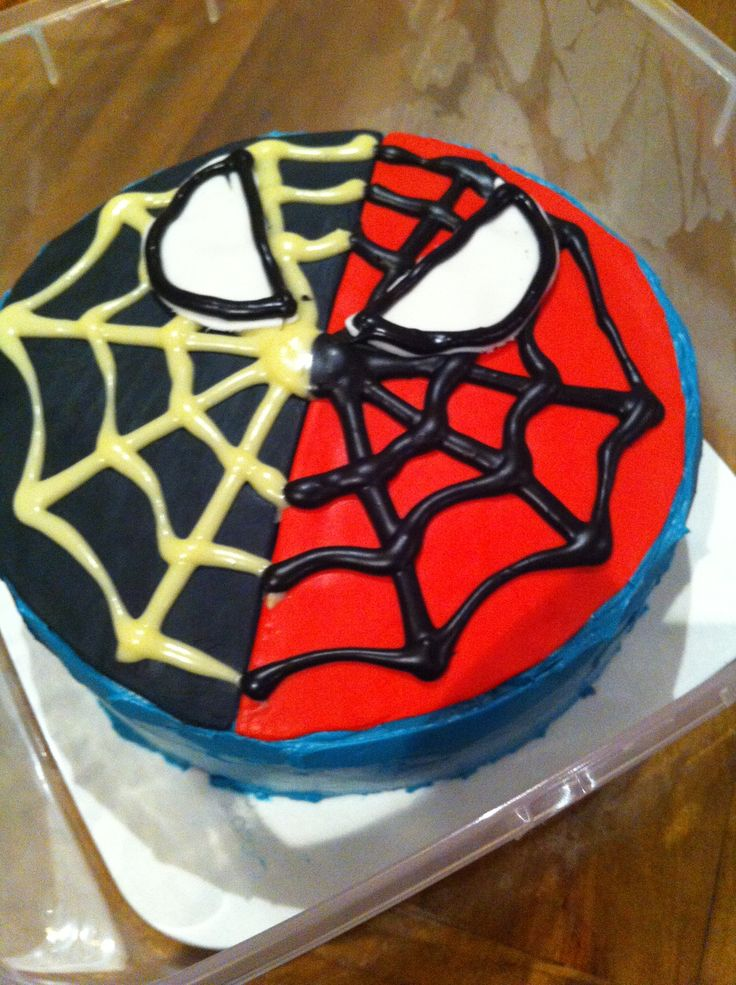 Spiderman cake Made using chocolate cake, swiss meringue buttercream, fondant and melted chocolate with one half coloured black